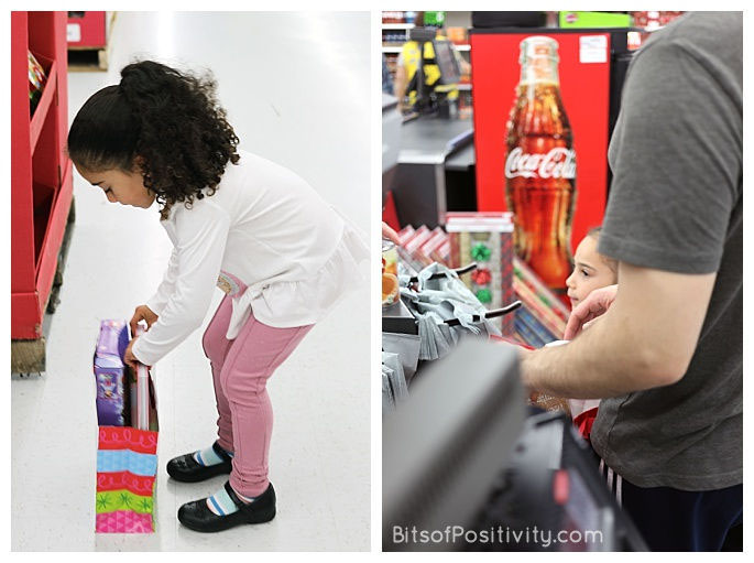 Putting the Book and Toy in a Gift Bag and Helping Her Dad Put Food in Another Gift Bag at the Checkout