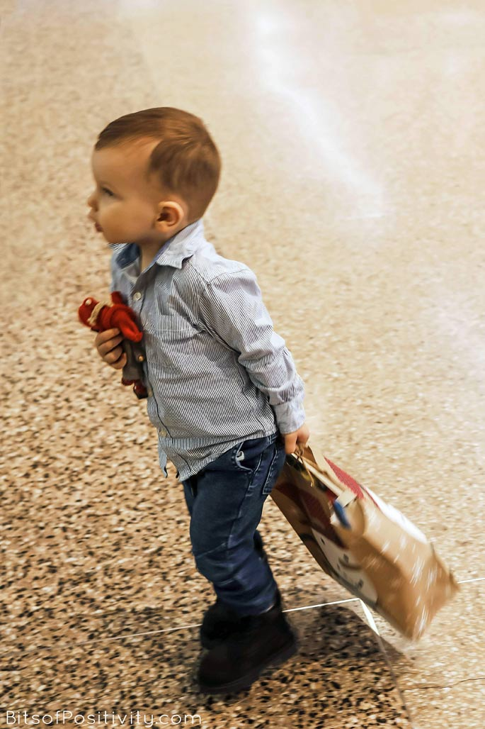Carrying the Kindness Elves and Gift Bag for a Toddler