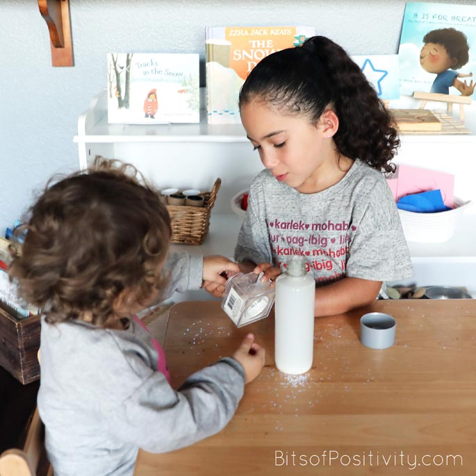 Helping Her Sister Put Glitter in the Winter Glitter Calming Bottle