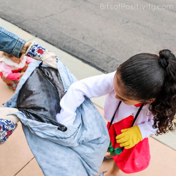 Picking up Litter on Family Litter Scavenger Hunt